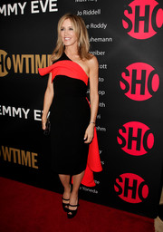 Felicity Huffman was superhero-chic in a black and red Peggy Hartanto one-shoulder dress with cape detailing at the Showtime Emmy eve party.