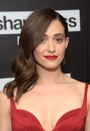 Emmy Rossum's lipstick was a perfect match to her dress.