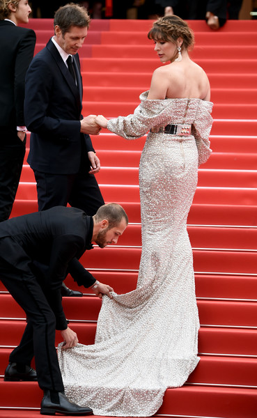 More Pics of Milla Jovovich Off-the-Shoulder Dress (1 of 29) - Milla Jovovich Lookbook - StyleBistro [red carpet,carpet,dress,red,gown,flooring,suit,premiere,event,fashion,sibyl,milla jovovich,sibyl red carpet,screening,cannes,france,the 72nd annual cannes film festival]