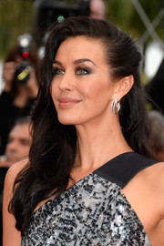 Megan Gale looked pretty with her wavy hair pinned back on one side during the 'Sicario' premiere in Cannes.