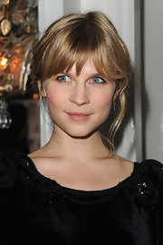 Clemence Poesy wore her blond hair in a simple updo with brow-grazing bangs and a few loose tendrils at the 2012 Sidaction Gala Dinner