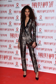 Cindy Bruna went the mannish route in a metallic tuxedo jumpsuit at the 2017 Sidaction Gala.