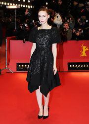 Rooney Mara looked adorably goth in this black cocktail dress with a handkerchief hem.