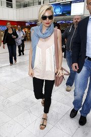 Sienna Miller was spotted at Nice Airport looking comfy in a loose blush blouse.