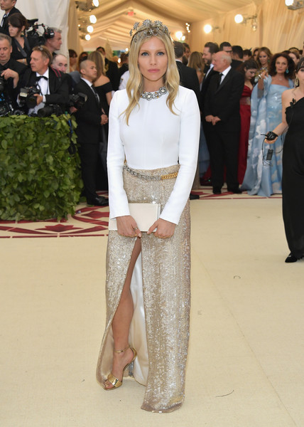 Sienna Miller Fitted Blouse [heavenly bodies: fashion the catholic imagination costume institute gala - arrivals,fashion model,flooring,fashion,carpet,haute couture,gown,outerwear,leg,girl,costume,new york city,metropolitan museum of art,sienna miller]