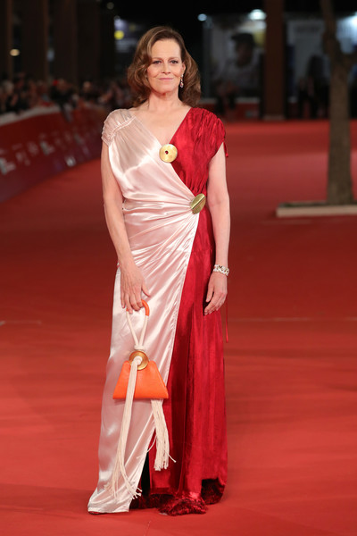 Sigourney Weaver styled her look with a tasseled orange wristlet, also by Marni.