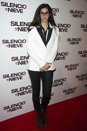 Alba paired her tux-inspired jacket with skinny jeans and brown combat boots.