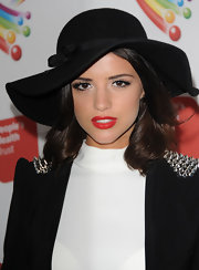 Lucy Mecklenburgh chose a black floppy hat with a cute side bow to top off her retro look.