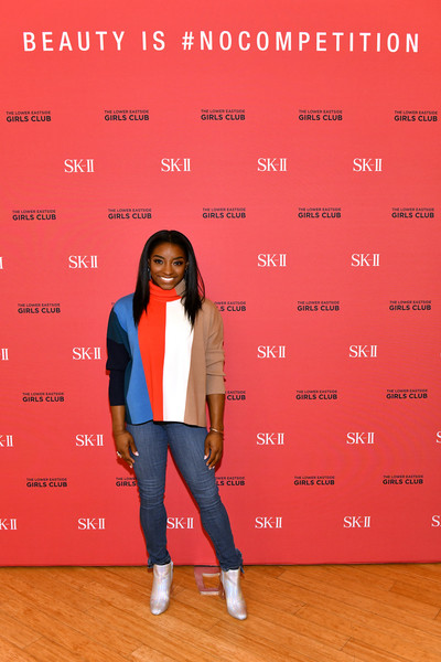 Simone Biles paired her top with blue skinny jeans.