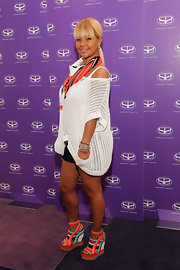 Misa Hylton Brim attended the Simone I. Smith trunk show at Neiman Marcus wearing a pair of colorful platform wedges.
