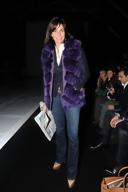 Cristina Parodi made a bold statement as she attended Milan's Fashion Week in a opulent deep purple fur vest.
