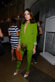 Olivia Culpo brought a bright pop to the Do What You Love fashion and beauty conference with this lime-green pantsuit.