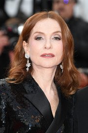 Isabelle Huppert wore her hair in a center-parted style with curly ends at the Cannes Film Festival screening of 'Sink or Swim.'
