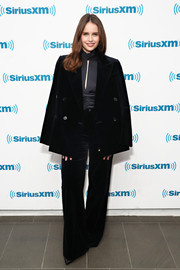 Felicity Jones gave us '70s vibes with this black velvet pantsuit while visiting SiriusXM.