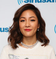 Constance Wu matched her necklace with a pair of dangling diamond earrings.