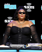 Lizzo looked cool wearing these blade sunglasses at Super Bowl LIV.