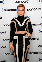 Florence Pugh stuck to a neutral palette for her visit to SiriusXM's Town Hall, teaming tan nail polish with a black, beige, and white outfit.