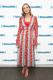 Emily Blunt looked cheery in a paneled floral frock by Carolina Herrera while visiting SiriusXM.