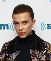 Millie Bobby Brown pulled her hair back into a tight bun for her visit to SiriusXM's 'Town Hall.'