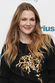 Drew Barrymore wore her long hair loose in a casual wavy style while visiting SiriusXM.