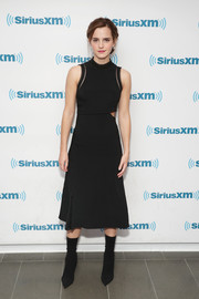 Emma Watson amped up the edge with a pair of black mid-calf boots.