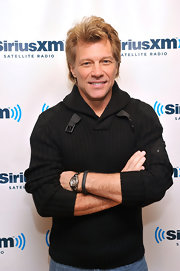 Rocker Jon Bon Jovi is still styling after all these years, especially in a casual ribbed sweater with buckles.