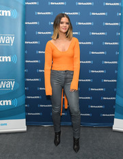 Maren Morris looked bright in an orange scoopneck sweater while visiting SiriusXM.