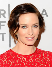 Emily Blunt wore her shiny auburn locks in a bobby pinned updo featuring wavy loose tendrils while attending the premiere of 'Your Sister's Sister.'