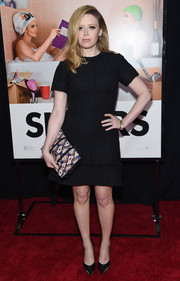 Natasha Lyonne accessorized with a printed clutch for some graphic appeal to her plain dress.