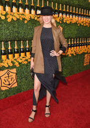 January Jones pulled her look together with a pair of chunky-heeled strappy sandals by Maison Martin Margiela.