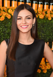 Victoria Justice showed off a sleek center-parted hairstyle at the Veuve Clicquot Polo Classic.