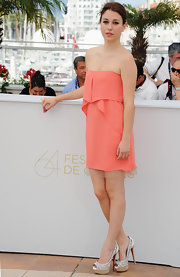 Blanca Suarez teamed her girlish strapless pink dress with white etched pumps with wooden platforms.