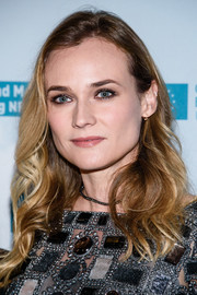 Diane Kruger framed her face with a side-swept medium wavy cut at the premiere of her film 'Sky' in Germany.