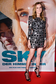 Diane Kruger dazzled in a long-sleeved mirrored Marc Jacobs mini dress while attending the premiere of her new film 'Sky' in Berlin.