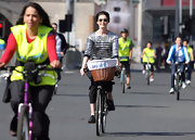 Model Erin O'Connor cycled down the street during Sky Ride Birmingham wearing a silver and black-striped three-quarter-sleeve sequin shirt.