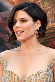 Neve Campbell matched her heavily embellished dress with a pair of gemstone earrings.