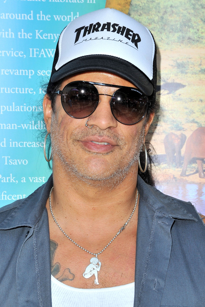 2c5535084b Slash s round sunglasses provided a sporty finish to his look during the  LAUSD Love Elephants Youth