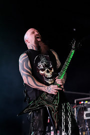 Slayer's Kerry King is covered in a gigantic tribal design tattoo.