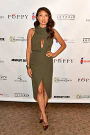Jeannie Mai gave us a pop of cleavage in this army-green cutout dress at the World Smile Day celebration.