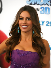 Sofia Vergara looked hot and glamorous at 'The Smurfs' premiere in a purple beaded Missoni dress. She finished off the look with contrasting turquoise earrings and full lashes.