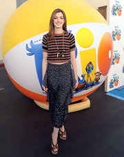 "Anne Hathaway rocked a more casual look at the ""Beak"" screening in brown leather sandals with cork platforms."