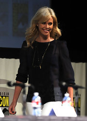 Stye star Charlize Theron paired her black and white ensemble with delicate layered gold necklaces.
