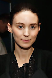 A simple nude lip kept Rooney's beauty look super soft and minimal.