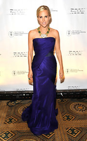 Tory looked elegant at the Cancer Center Spring Ball in a strapless purple evening dress.