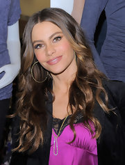 Sofia Vergara's locks were shiny and flowing at the Sofia by Sofia Vergara collection launch. To try her look at home, curl two-inch sections of hair with a large-barreled curling iron, then finger comb waves and tousle slightly. To finish tyr a product like ALTERNA Caviar Anti-Aging Rapid Repair Spray for added shine.