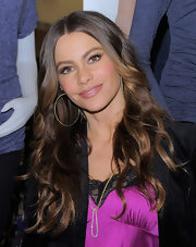 Sofia Vergara eyes were lit up at the Sofia by Sofia Vergara collection launch. To try her flirty look, first line top and bottom lash lines with a dark eye pencil. Use lash glue to attach false lash strips to upper lash lines and finish with a generous coat of mascara.