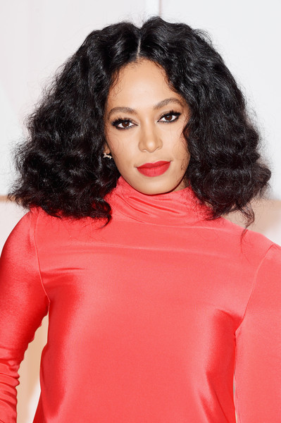 Solange Knowles Medium Curls [hair,lip,face,clothing,red,hairstyle,black hair,eyebrow,beauty,shoulder,hollywood highland center,california,87th annual academy awards,arrivals,solange knowles]