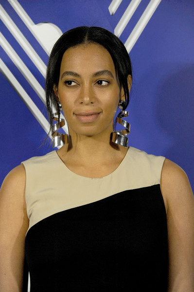 Solange Knowles Loose Bun [hair,hairstyle,shoulder,eyebrow,beauty,forehead,black hair,electric blue,neck,long hair,reed,solange knowles,pr showroom,kohl,collection launch dinner]