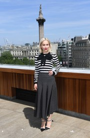 Emilia Clarke looked adorable in her Michael Kors polka-dot skirt and striped top combo.