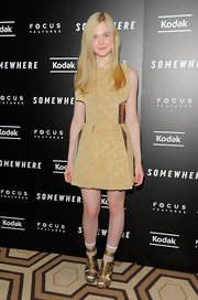 Elle Fanning wore a darling Rodarte dress to the premiere of 'Somewhere'. She completed her golden look with blond straight locks.